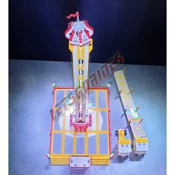 """LetsGoRides - Free Fall Tower, Motorized reproduction of the fairground attraction """"Free Fall Tower"""" made with Lego bricks. Fol"""